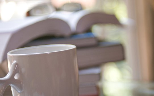 15973-a-cup-of-coffee-with-a-stack-of-books-pv